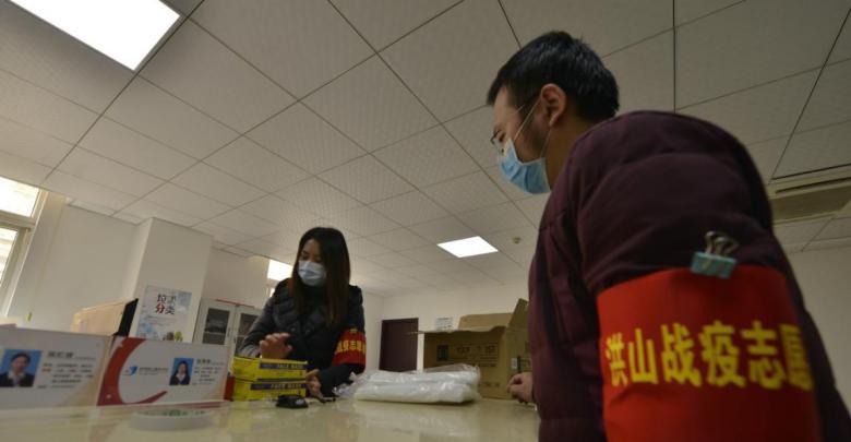 武汉社区干部:先锋不倒坚守岗位凝聚力量联防疫情